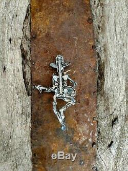 Kit Carson Skeleton Musician. Sterling silver + semi precious. Pendant/pin