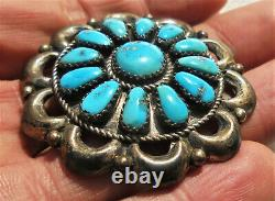 Navajo silver Zuni pin with turquoise signed E. Wilson